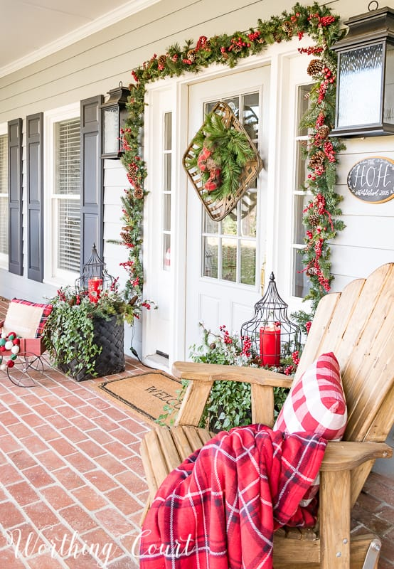 Festive Christmas front porch with red and green decorations #christmas #christmasporch