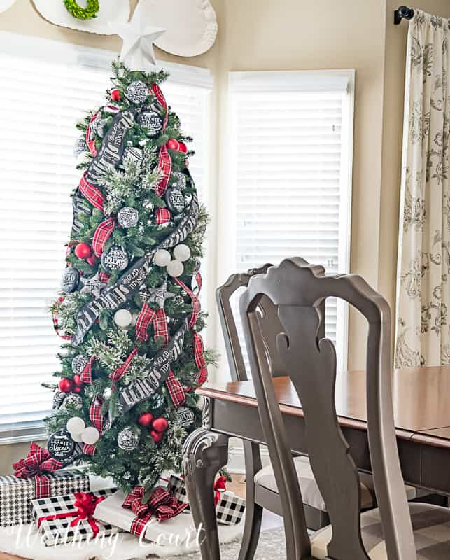 Christmas tree with red, black and white decorations #christmasdecor #christmastrees