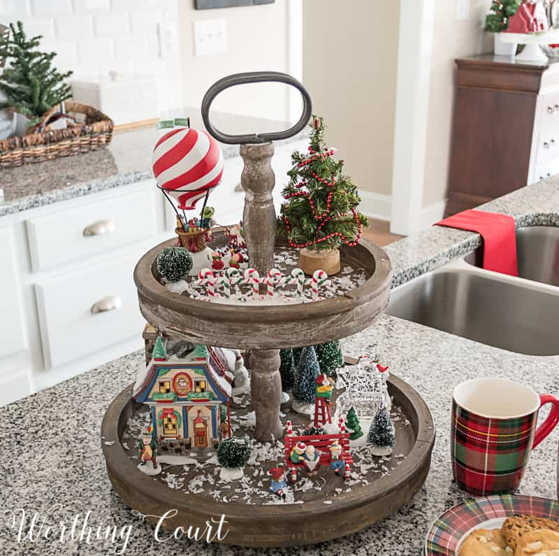 Farmhouse wooden tiered tray filled with Christmas decorations #christmasdecor