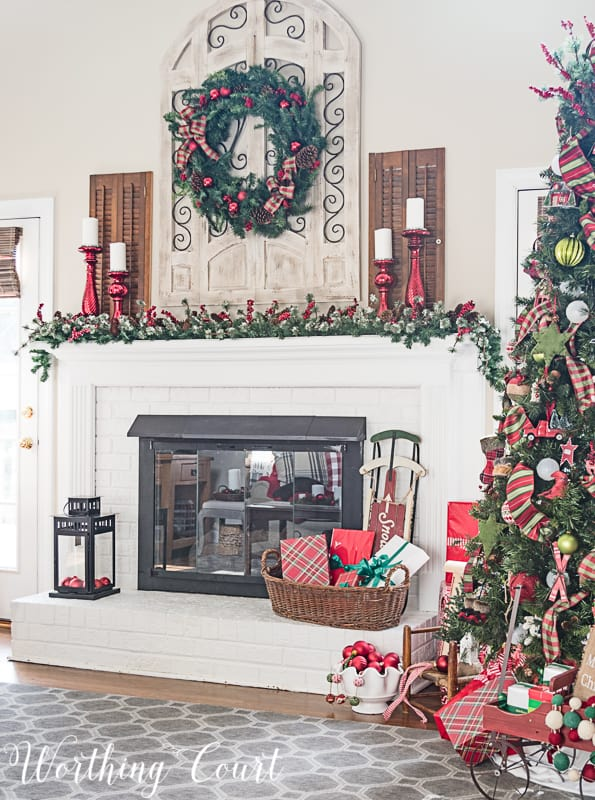 Fireplace and mantel with Christmas decor #christmasdecor #christmasmantel