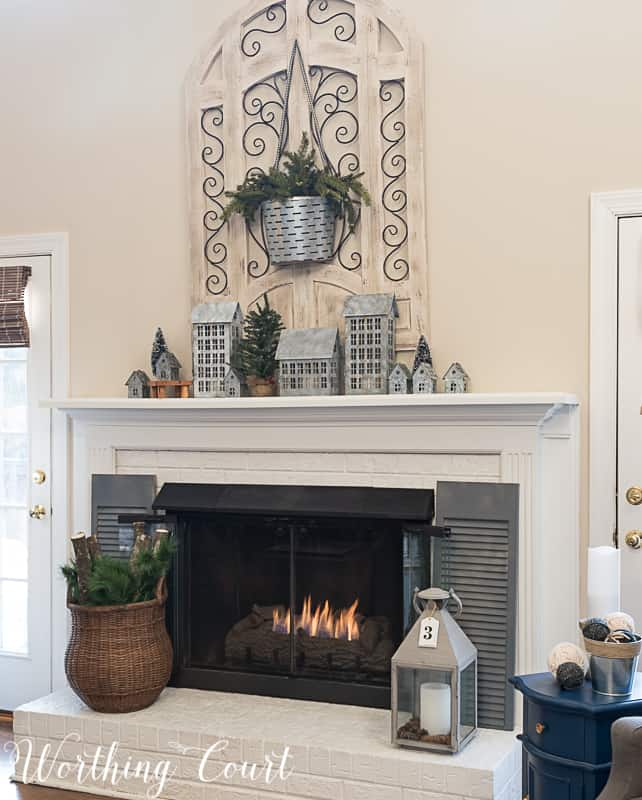 Painted brick fireplace, winter decorations, winter mantel