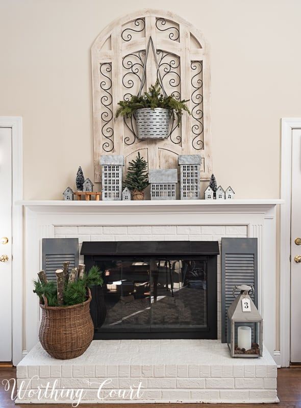 fireplace with winter decor, farmhouse fireplace, painted brick fireplace