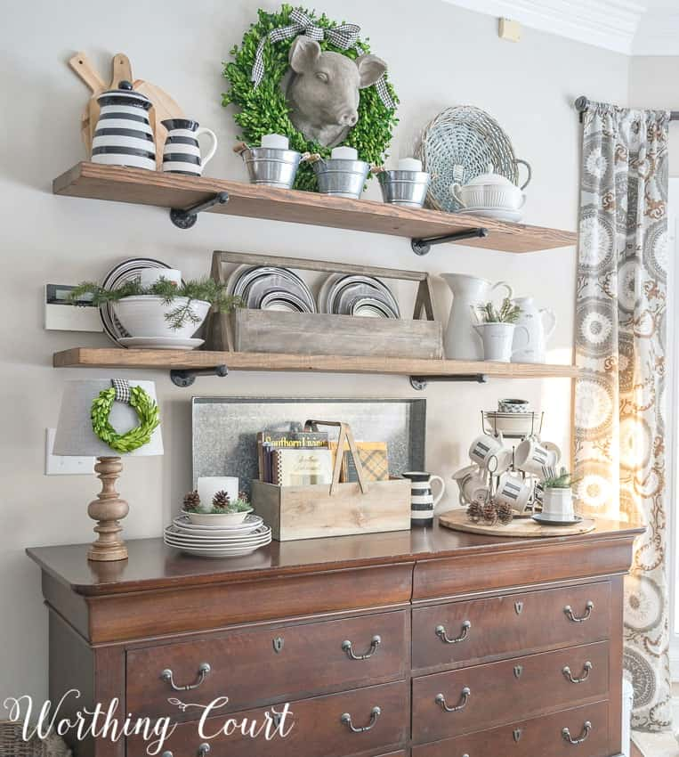 Rustic farmhouse open shelves decorated for winter with black and white dishes, wood tones, greenery and galvanized metal #winterdecor