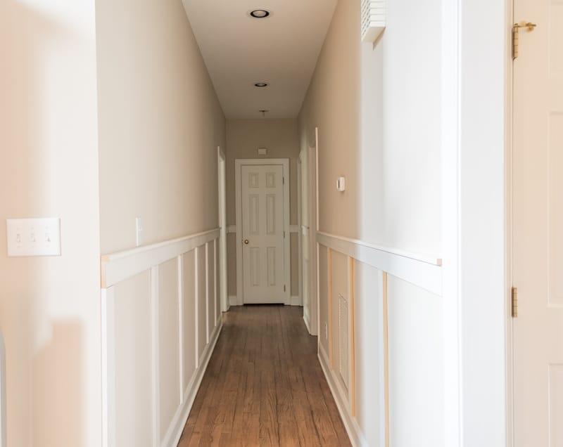 The long hallways painted a bright white and the carpet removed.