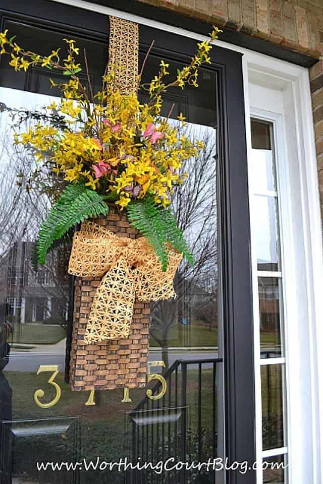 Spring door basket filled with faux flowers #springdecor #springwreath #wreath