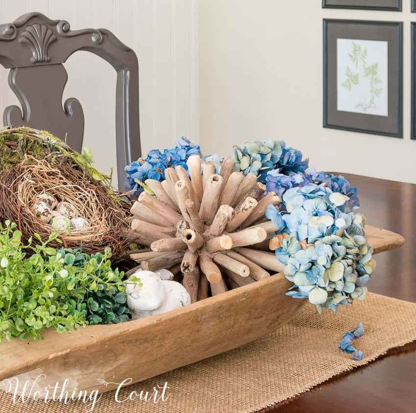 Dough bowl spring centerpiece layered with texture and hydrangeas #springdecor #centerpiece #doughbowl #hydrangeas