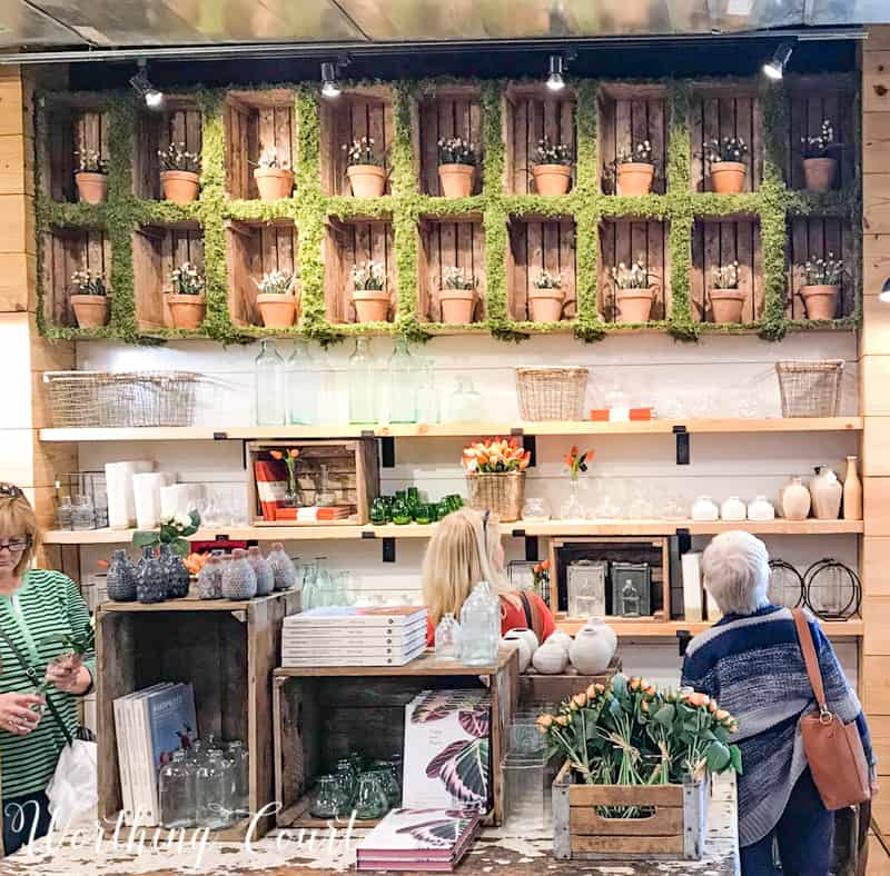 Moss covered cubbies in Magnolia Market. This would be easy to replicate with a small cubbie organizer. #decoratingideas #magnoliamarket #fixerupper #moss #springdecoratingideas