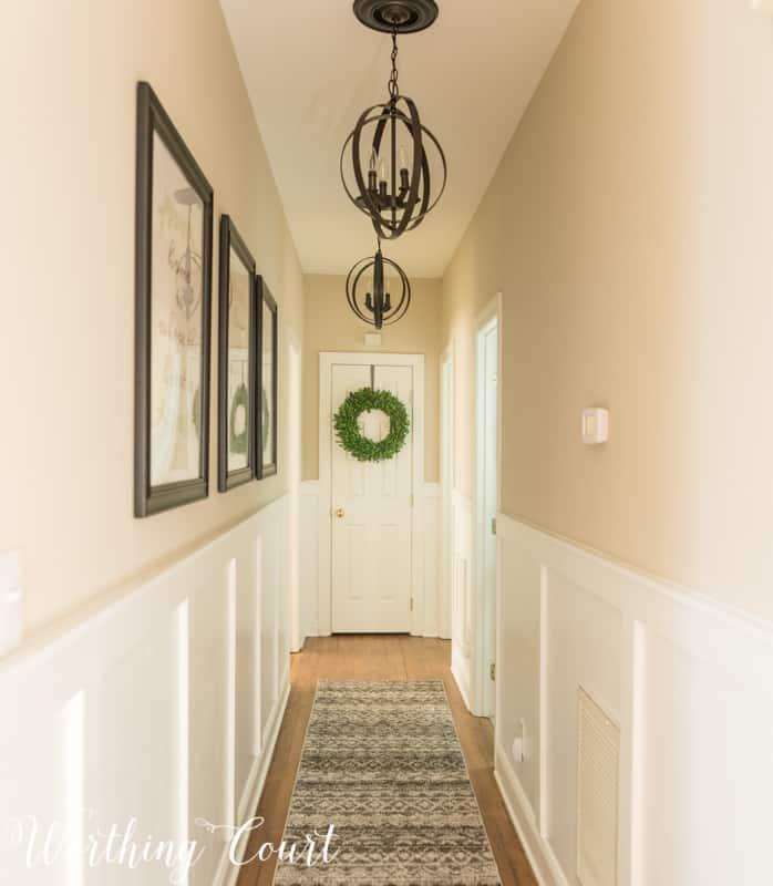 Long dark hallway makeover #boardandbatten #makeover #hallway