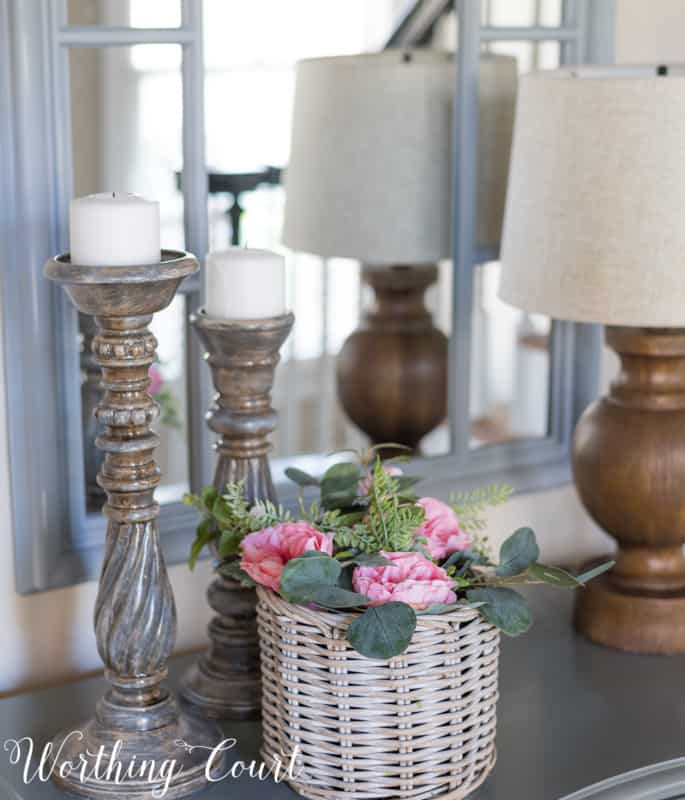 Entryway vignette with pink roses and gray candlesticks