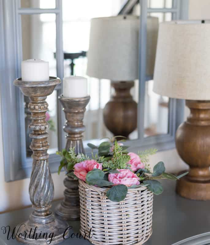 Foyer vignette with pink roses and gray candlesticks #foyerideas #entrywayideas #vignetteideas