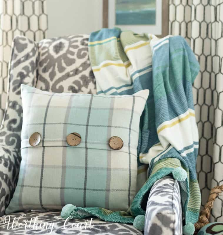 Ikat, stripes and plaid mixed together for interest #howtomixpatterns #coastaldecor #coastaldecoratingideas #turquoise #aqua