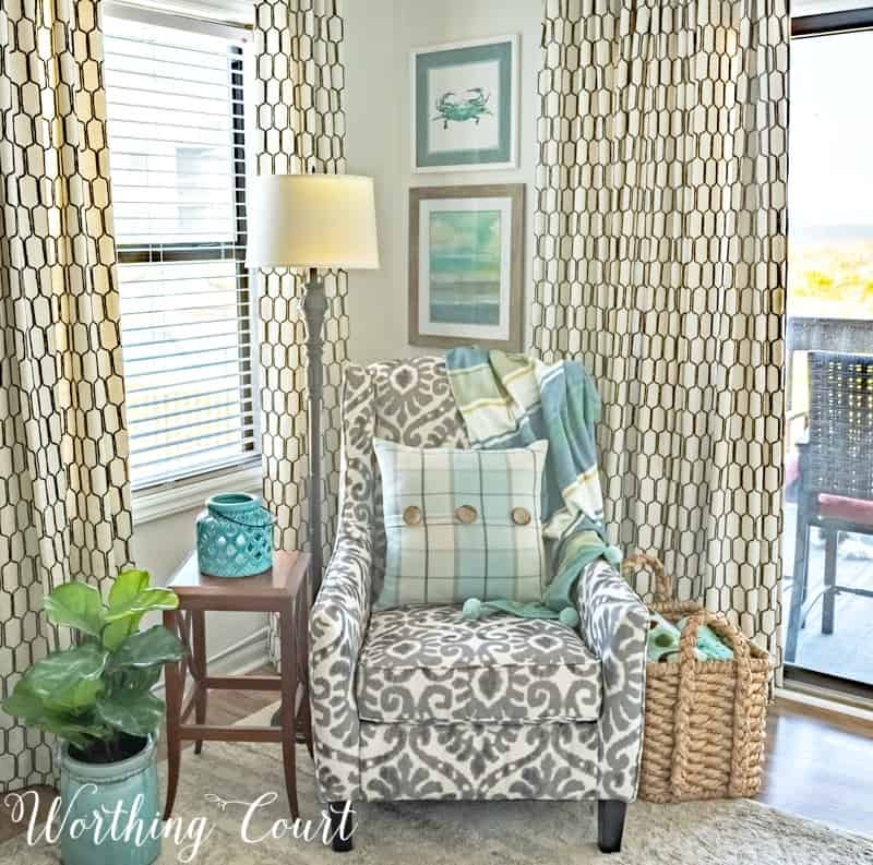 Perk up a tired room with the addition of color in the form of a pretty throw, wall art and pillow. #decorideas #decoratingideas #turquoise #aqua #coastaldecoratingideas #coastaldecor
