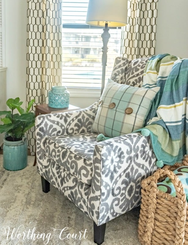 Turquoise, aqua and gray coastal decor #coastaldecor #coastaldecoratingideas #turquoise #aqua #accentchair #howtomixpatterns