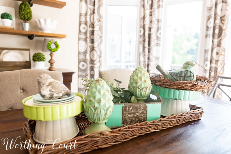 Dining table centerpiece using blue and aqua accessories from the #TrishaYearwood Collection at #TractorSupply #springdecor #springdecoratingideas #centerpieceideas #aqua #limegreen #HomeDecor #SouthernStyle