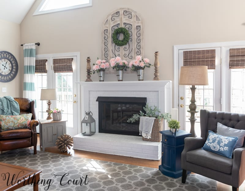 Fireplace and family room decorated for spring #springdecoratingideas #fireplacedecoratingideas #springdecor #farmhouse #paintedbrick