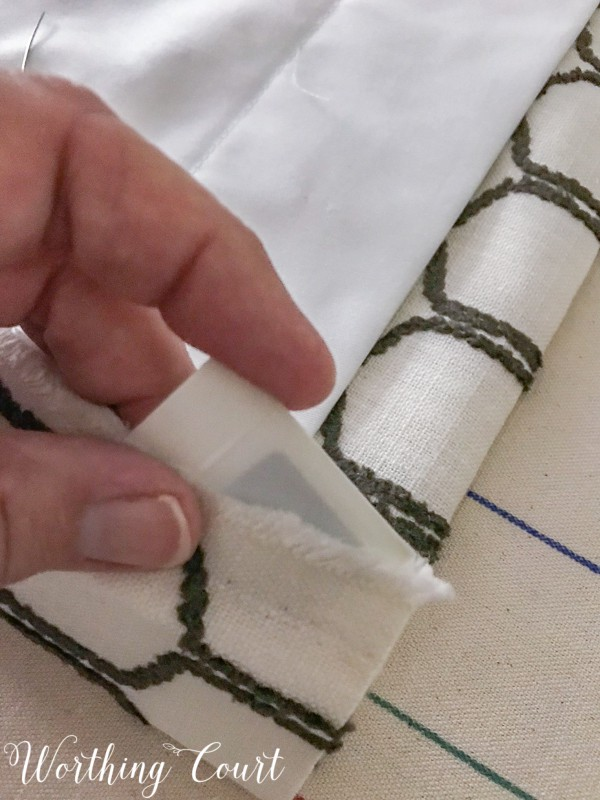 How To Make A Lined, Flat Drapes Just Like The Pros Do - It's Easy! How to insert a drapery weight into the bottom corner of drapes. #drapesforlivingroom #curtains #draperies #draperypanels #diydrapes #diycurtains #drapetechniques #drapesforslidingglassdoors #windowdrapes