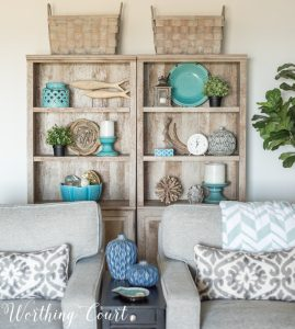 gray bookcases with baskets on top and decorative accessories