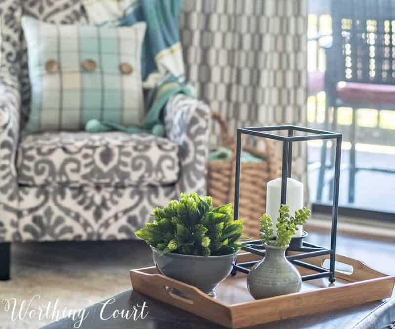 A Living Room Makeover Created With Summer In Mind - Before And After Room Reveal! Modern farmhouse coffee table vignette. #summerdecor #summerdecoratingideas #livingroomdecor #familyroomdecor #modernfarmhousedecoratingideas #WorthingCourtBlog # #neutraldecoratingideas coastaldecoratingideas
