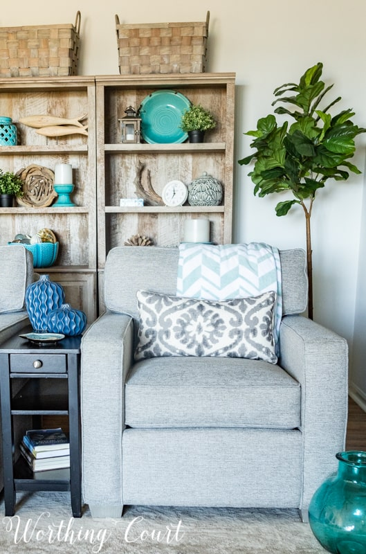 A Living Room Makeover Created With Summer In Mind - Before And After Room Reveal! Artificial trees help to fill empty corners in a room. #summerdecor #summerdecoratingideas #livingroomdecor #familyroomdecor #modernfarmhousedecoratingideas #WorthingCourtBlog # #neutraldecoratingideas coastaldecoratingideas