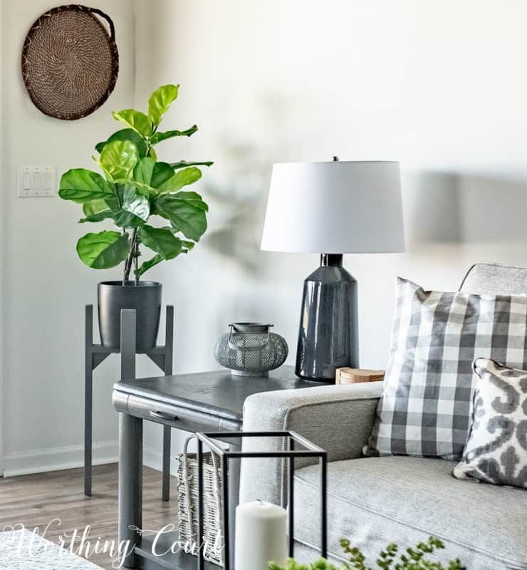 A Living Room Makeover Created With Summer In Mind - Before And After Room Reveal! Faux fiddle leaf fig on a modern plant stand. #summerdecor #summerdecoratingideas #livingroomdecor #familyroomdecor #modernfarmhousedecoratingideas #WorthingCourtBlog # #neutraldecoratingideas coastaldecoratingideas