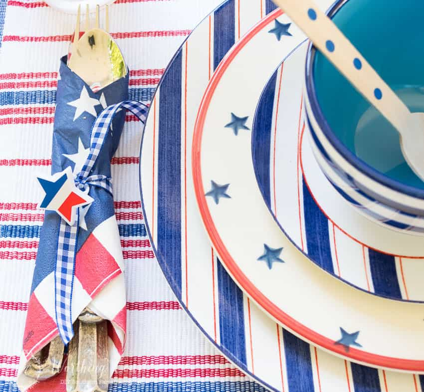 Red and blue patriotic tablescape for July 4th. #july4thdecorations #patrioticdecorations #redwhiteandblue #july4thideas