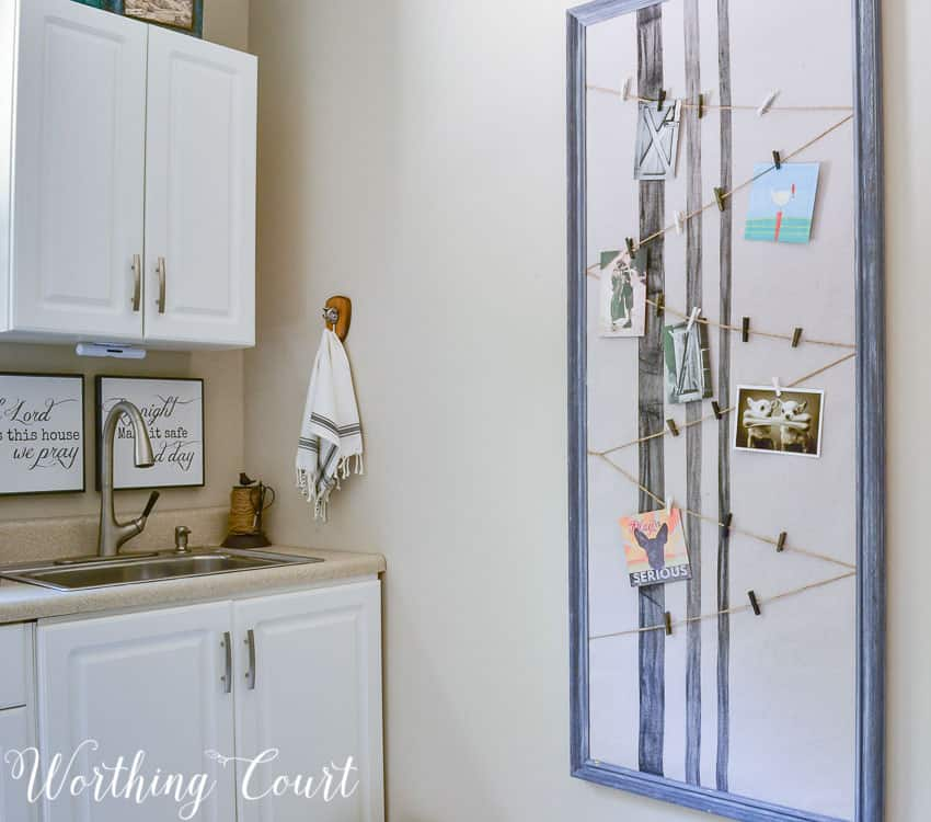 DIY flour sack bulletin board adds farmhouse flair with function, too, in the laundry room. #worthingcourtblog #functionalfarmhouse #DIYbulletinboard