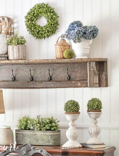 Farmhouse-Dining-Room-Makeover-with-planked-wall-diy-hanging-lanterns-vintage-shelf-with-white-accessories