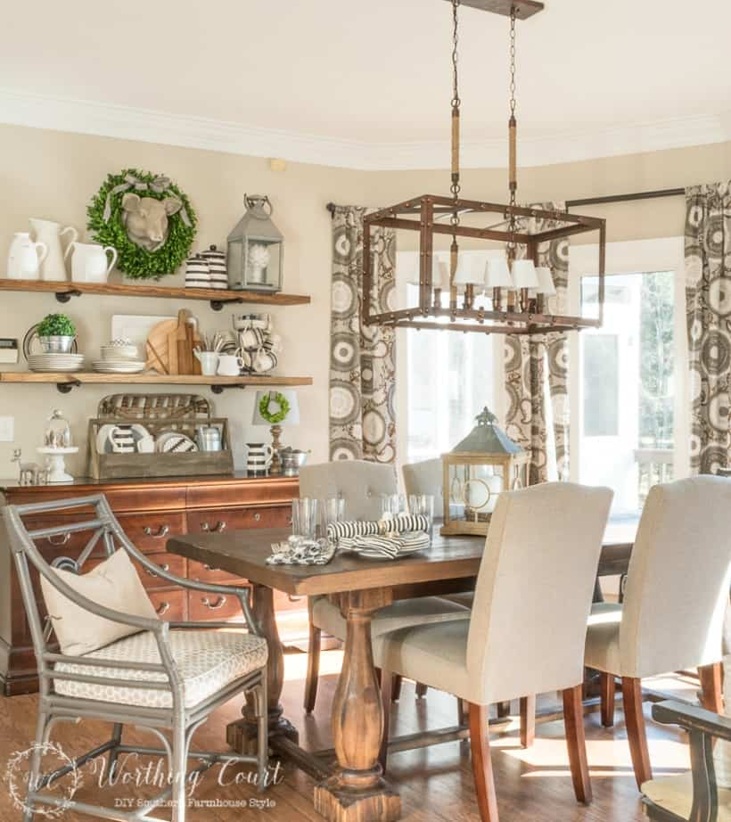 Farmhouse breakfast room with neutral colors and rustic industrial open shelves. #farmhousedecor #rusticfarmhouse #breakfastroom #decoratingideas #farmhousedecoratingideas #largechandelier #rusticchandelier
