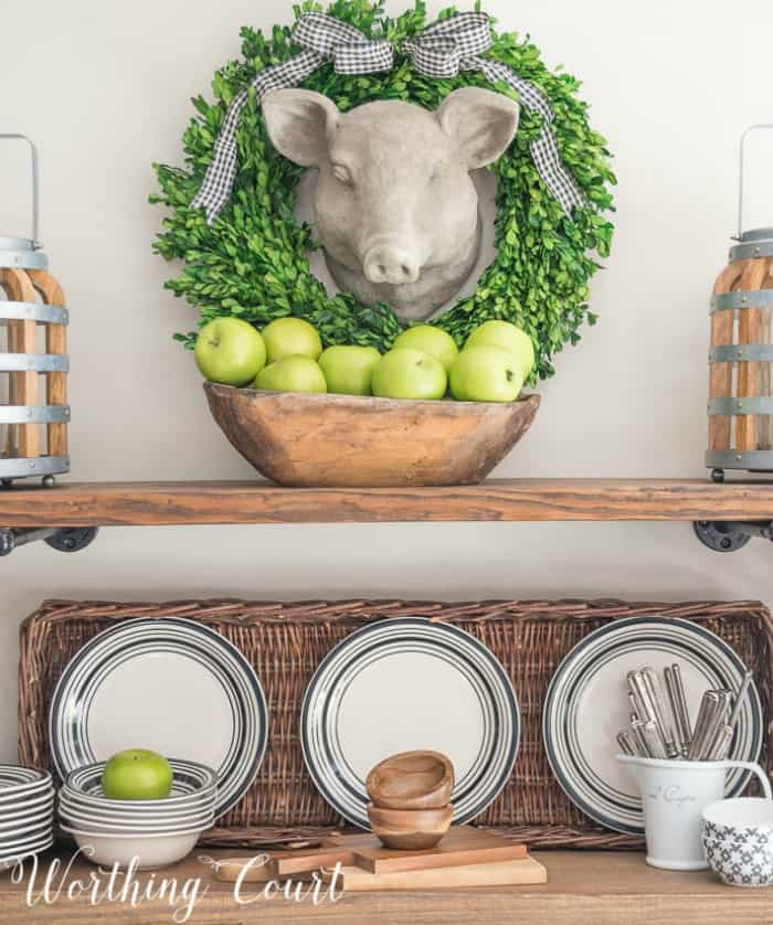 A faux pig head surrounded by a preserved boxwood wreath. #artideas #wallartideas #artworkideas #diyart #artworkdisplay #fauxpighead