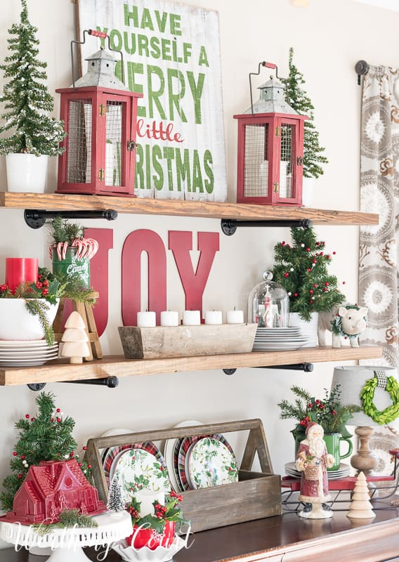 Use a reproduction vintage toolbox to display seasonal plates #christmasdecor #christmasshelves #christmasdecoratingideas