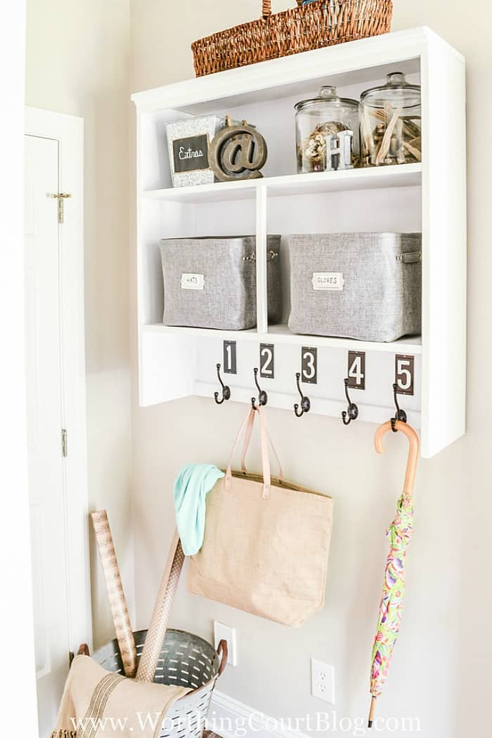 Need a place to keep those coats, bookbags and purses? Repurpose the top of an old hutch into a dropzone and mount it on the wall. #organizingideas #dropzoneideas #mudroomideas.#upcyclingideas #repurposedfurniture #repurpose #upcycledfurniture #upcycledideas