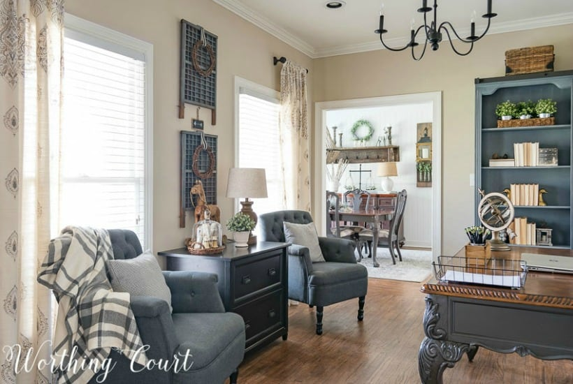 Farmhouse style home office and dining room with gray accent arm chairs and printer's trays for wall art. #officedecor #decoratingtips #howtodecorate #decoratingideas #homeoffice #vintagedecor #cottagedecor