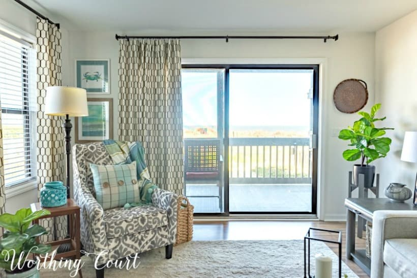 Video tour of completely remodeled living room, dining room and kitchen of a beach condo. #coastaldecor #beachdecor #coastalliving #coastaldecoratingideas