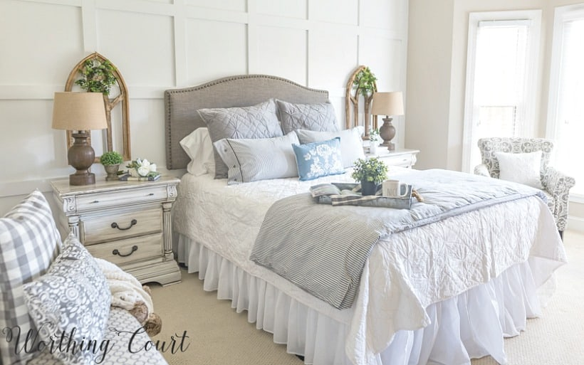 Farmhouse style bedroom with gray upholstered headboard, ticking stripe duvet set, diy painted furniture and gothic arch wall decor #farmhousedecor #cottagedecor #shabbychicdecor #bedroomdecor #decoratingideas #bedroomdecoratingideas