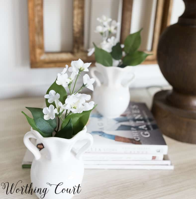 white vases filled with tiny white flowers