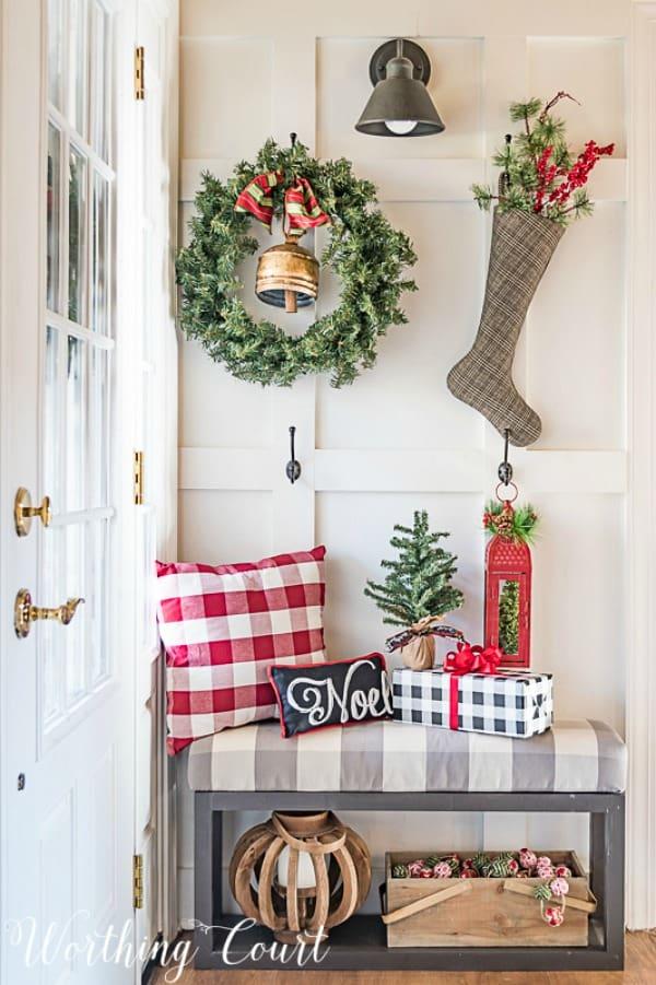 "Hooks added to a board and batten wall hold seasonal decorations and become ""art"". #artideas #wallartideas #artworkideas #diyart #artworkdisplay"