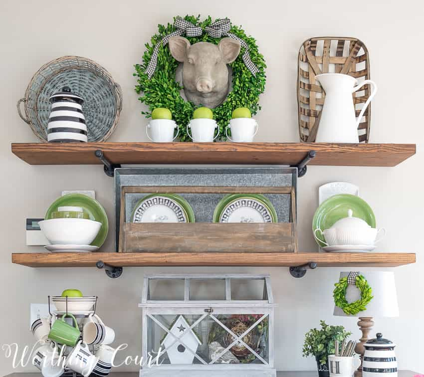diy shelves filled with thrifted treasures are a great way to decorate on a budget