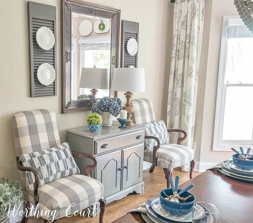 Plates on brackets add an unexpected element to these shutters. #worthingcourtblog #unexpecteddecor #farmhousefinds