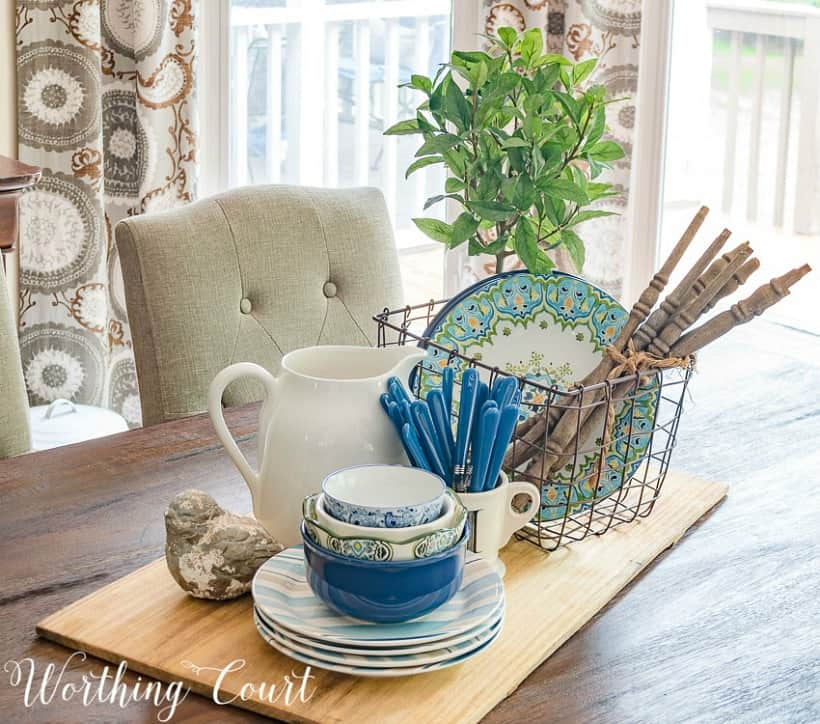 spring centerpiece with blue and white dishes