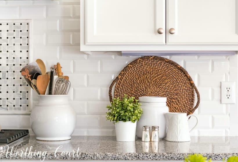 white-beveled-subway-tile-backsplash-with-granite-counters-and-white-kitchen-accessories.