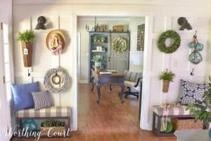 White board and batten wall with hooks and summer decorations