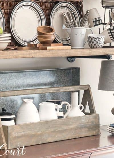 Black And White Accessories On Open Farmhouse Kitchen Shelves