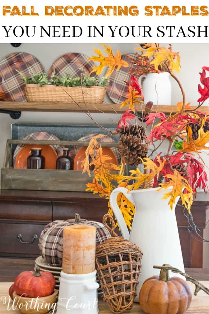 Fall centerpiece with traditional fall foliage poster.