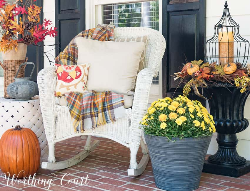 outdoor chair with a fall throw and fall throw pillows