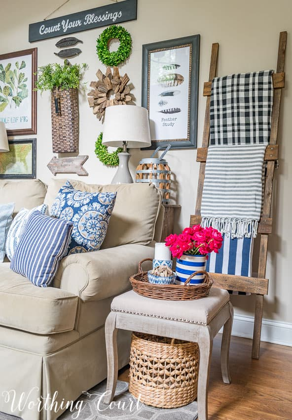 rustic wood ladder with summer blankets displayed