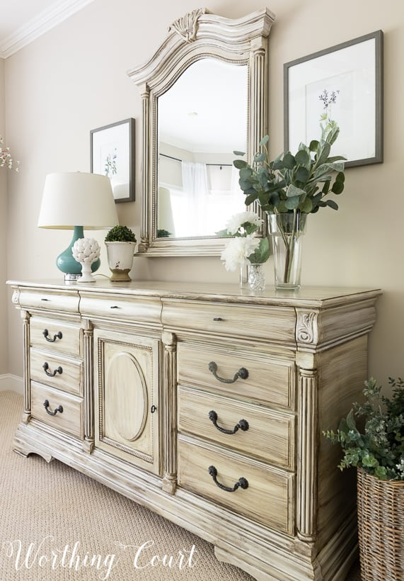 Traditional white dresser painted white with gray wash paint