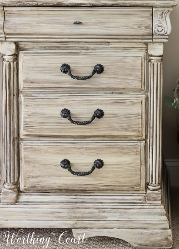 traditional bedroom dresser painted white with a gray wash finish