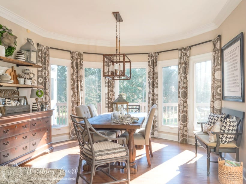 breakfast room with neutral colors and bay window