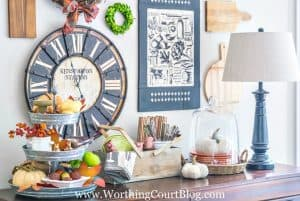 sideboard decorated for fall with traditional fall colors