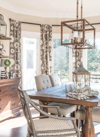 farmhouse breakfast room with bay window and open shelves